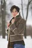 Beauty Girl in frosty winter Park. Outdoors. Flying Snowflakes. Stock Photography