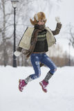 Beauty Girl in frosty winter Park. Outdoors. Flying Snowflakes. Stock Image