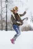 Beauty Girl in frosty winter Park. Outdoors. Flying Snowflakes. Royalty Free Stock Photos