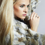 Beauty Girl in Fur Coat. Beautiful Luxury Winter Woman.Blond girl Royalty Free Stock Photo