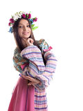 Beauty girl with garland posing in russian costume Royalty Free Stock Image