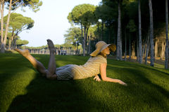 Beauty girl on golf field at sunset Stock Images