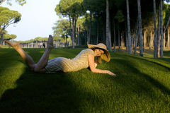 Beauty girl on golf field at sunset Stock Photos