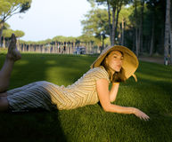 Beauty girl on golf field at sunset Royalty Free Stock Photo