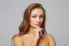 A beauty girl, on gray background Stock Image