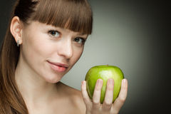 Beauty girl with green apple Royalty Free Stock Image