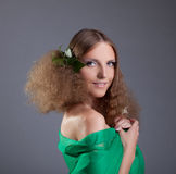 Beauty girl with hair style smile in green cloth Royalty Free Stock Photos