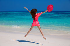 Beauty girl. Happiness bliss freedom beach concept. Enjoyment. B. Eautiful woman jumping on exotic beach with white sand and blue water. Travel. Free. Vacation Royalty Free Stock Photos