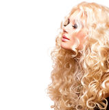 Beauty Girl With Healthy Long Curly Hair royalty free stock photography