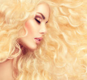 Beauty girl with healthy long curly hair royalty free stock photos