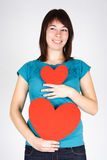 Beauty girl holding two paper hearts, smiling Stock Photography