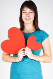 Beauty girl holding two paper hearts, smiling Royalty Free Stock Photo