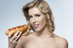 Beauty girl with hot-dog Stock Images