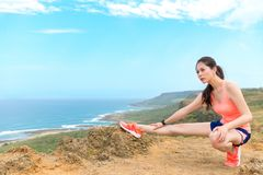 Beauty girl jogger on mountain viewing landscape Stock Images