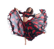 Beauty girl jump in gypsy dance isolated Stock Photos