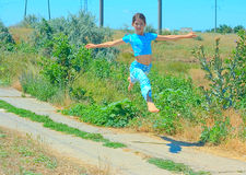 Beauty girl jump on nature Royalty Free Stock Images
