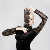 Beauty girl with lace mask. Blonde beauty girl with lace mask.Young beautiful woman with red lips royalty free stock photos