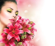 Beauty girl with lilly flowers Stock Photo