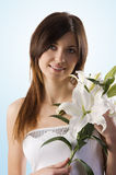 Beauty girl with lily Royalty Free Stock Photography