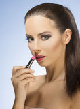 Beauty girl with lipstick royalty free stock photo