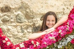 Beauty girl with long hair smile with floral decor, spring. Beauty child, look, hairstyle stock image