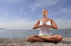 Beauty girl in lotus pose Royalty Free Stock Image