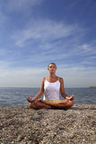 Beauty girl in lotus pose Stock Images