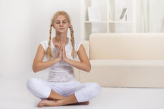 Beauty girl in lotus pose Royalty Free Stock Photography