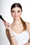 Beauty Girl make up artist with Makeup Brush. Bright Holiday Make-up for Brunette Woman with Brown Eyes.  Beautiful Face. Makeover Stock Photos