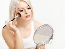 Beauty Girl with Makeup Brush. Daily Make-up for Blond Woman. Royalty Free Stock Photos
