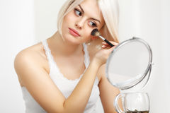 Beauty Girl with Makeup Brush. Daily Make-up for Blond Woman. Be Stock Images