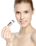 Beauty Girl with Makeup Brush. Natural Make-up. Nude make-up. Be Royalty Free Stock Photography