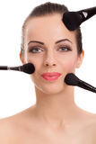 Beauty girl with makeup brushes Stock Image