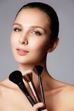 Beauty Girl with Makeup Brushes. Natural Make-up for Brunette Wo Stock Photography