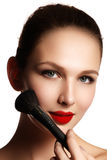 Beauty Girl with Makeup Brushes. Natural Make-up for Brunette Wo Stock Photos