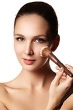 Beauty Girl with Makeup Brushes. Natural Make-up for Brunette Wo Stock Photo