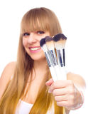 Beauty Girl with Makeup Brushes Stock Photos