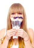 Beauty Girl with Makeup Brushes Royalty Free Stock Images