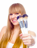 Beauty Girl with Makeup Brushes Royalty Free Stock Image