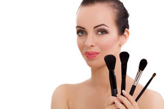 Beauty girl with makeup brushes royalty free stock photo
