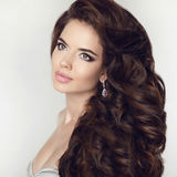 Beauty girl makeup. Healthy long hair style. Curly hairstyle. He Royalty Free Stock Photos