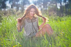 Beauty girl on the meadow Stock Photography