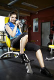 Beauty girl in modern fitness Stock Photography