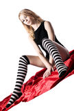 Beauty girl with naked buttocks and striped socks Stock Image
