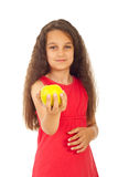 Beauty girl offering apple. Beauty girl offering yellow apple isolated on white background Stock Image