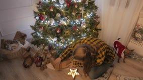 Beauty girl opens Christmas gift box. 4K UHD stock video