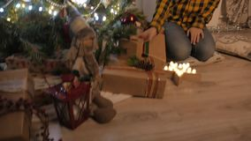 Beauty girl opens Christmas gift box. 4K UHD stock footage