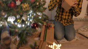 Beauty girl opens Christmas gift box. 4K UHD stock video footage