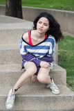 Beauty Girl Outdoors. Relax in park. Beautiful Teenage Model stock photography