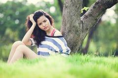 Beauty Girl Outdoors. In park. Beautiful Teenage Model royalty free stock photo